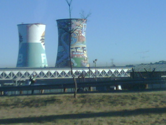 Watching the sunrise over the Orlando Cooling towers, soweto.