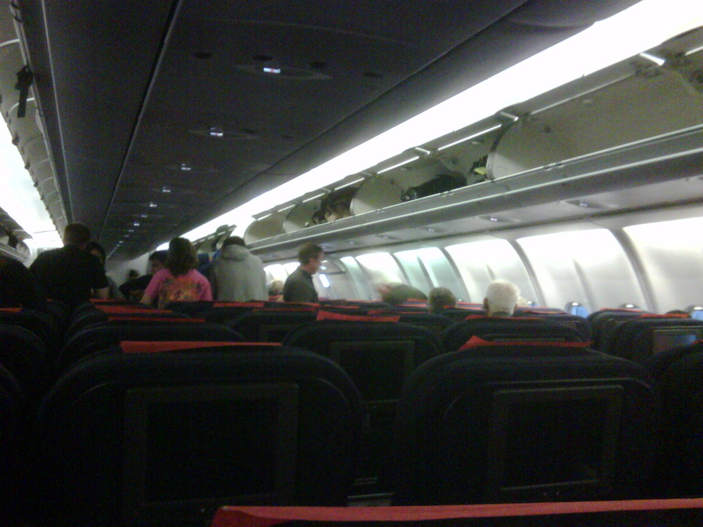 Empty plane; gonna kill for the 3 empty seats next to me!