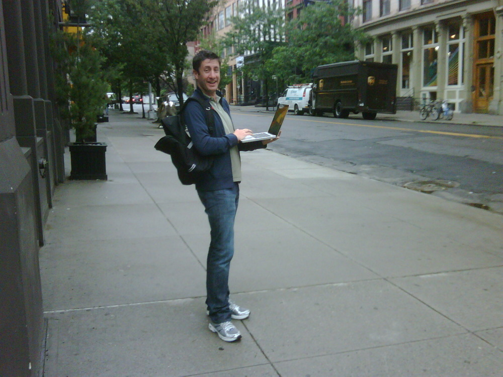 Enjoying the free wi-fi in the city, just hope the mac is waterproof!