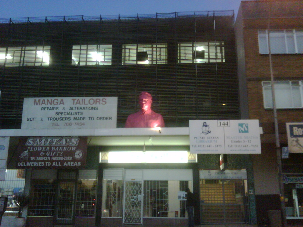 The large pink bust that greets me twice a day in my hood!