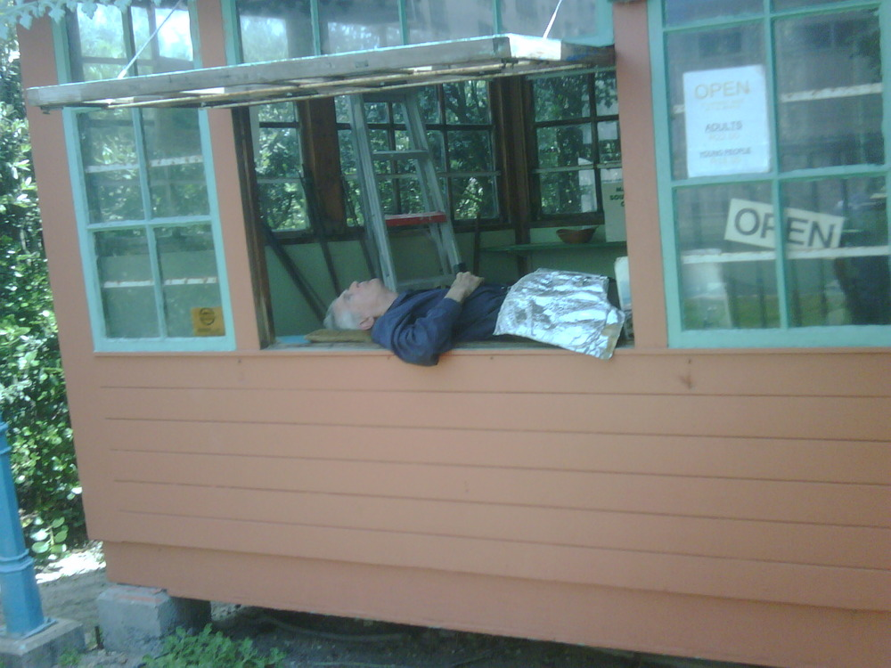 Old man sleeping with hand on crotch in kiddies theme park. Come play kids..