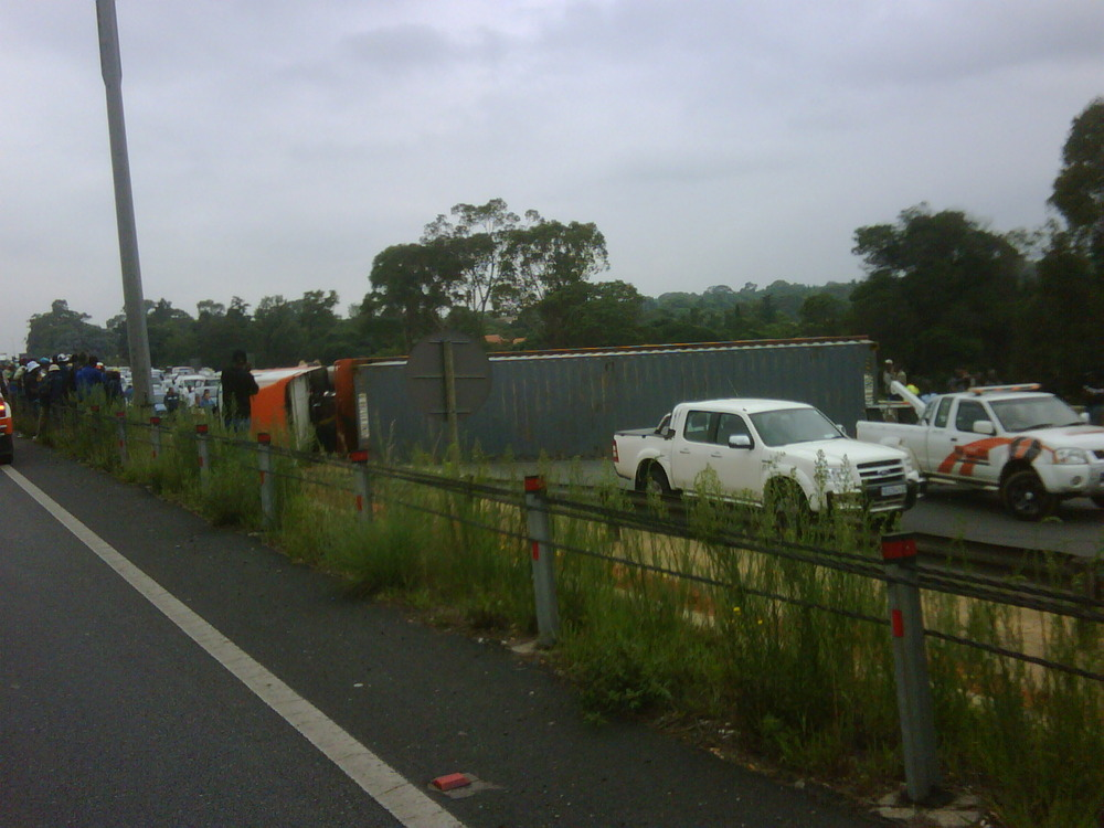 Truck rolled blocking all lanes N1 south before Rivonia. Km's backup. #jhbtraffic