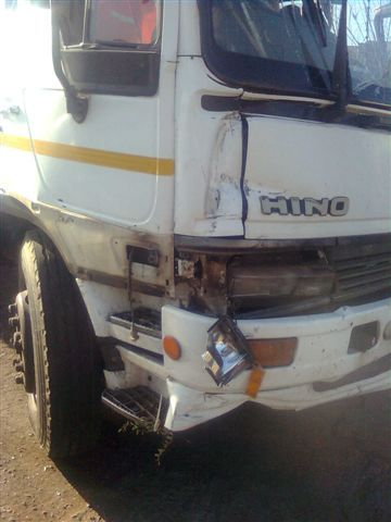 images of the work truck that went through a wall on Saturday. (and you are fired!)