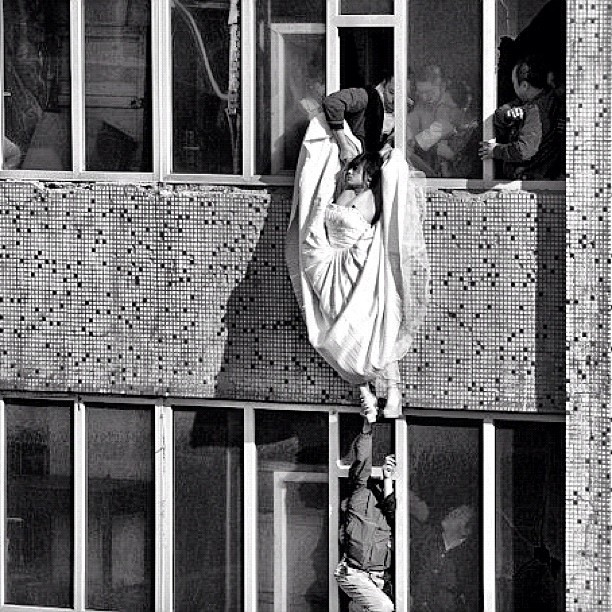 This is the photo that in my opinion wins photo of the year. It was taken in china during May this year. The 22 year old bride tried to commit suicide by jumping out the 7th story window after her groom decided not to marry her on the day of the wedding.