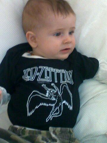 Led Zeppelin kids rock! Give it horns kid!!!